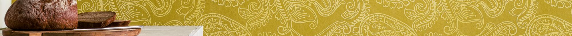Slider Innenbereich von Oskar Seus Wand mit gelbem Paisley Muster